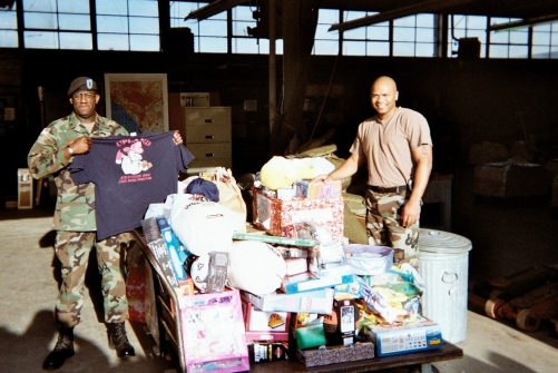 CW2 Fochen Horton Jr. and SGT of the 163 Ord Company with their units Christmas gifts, 2004