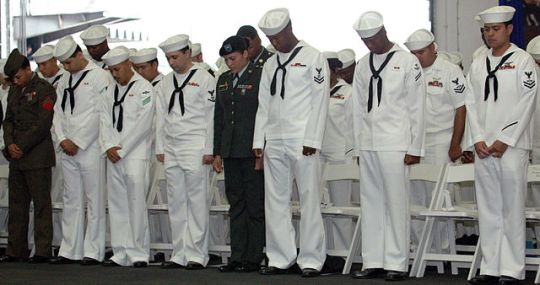 diers_bow_their_heads_in_prayer_at_the_conclusion_of_a_naturalization_ceremony_held_aboard_the_Nimitz-class_aircraft_carrier_USS_George_Washington_(CVN_73)
